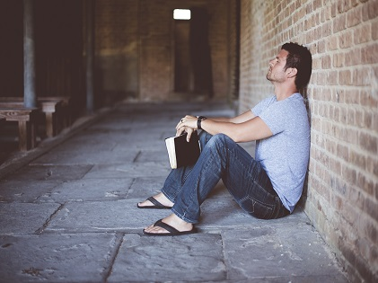 man sitting thinking